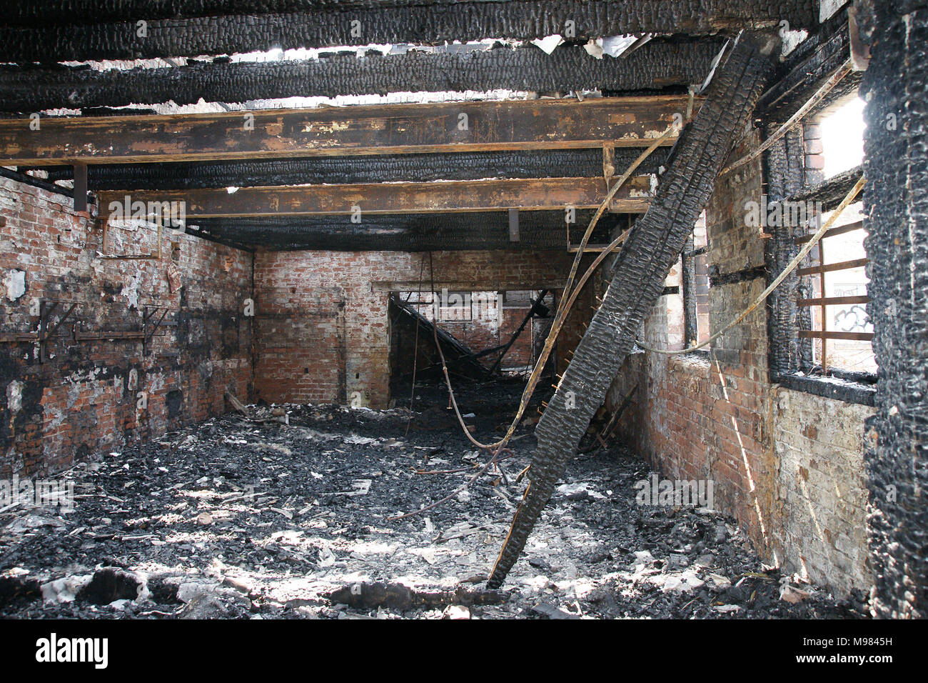 building destroyed by fire ,fire investigation crime scene - Stock Image