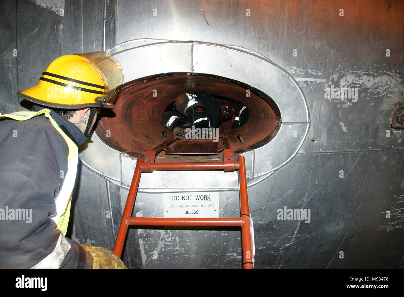 fire fighter dealing with technical rescue operation, the rescue and recovery of victims trapped in a confined space - Stock Image