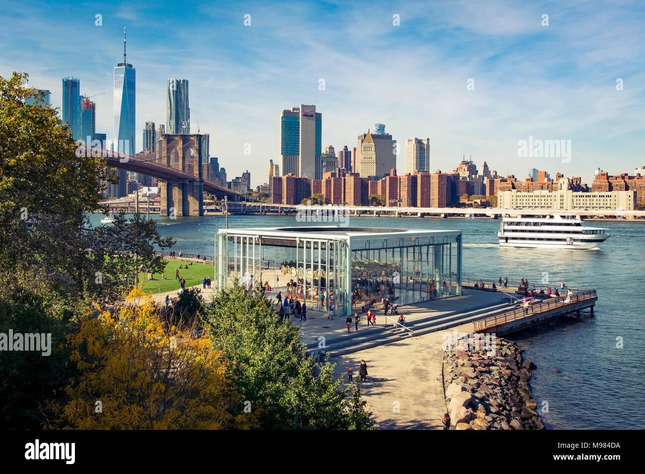 USA, New York City, skyline and Brooklyn Bridge with Jane's Carousel - Stock Image