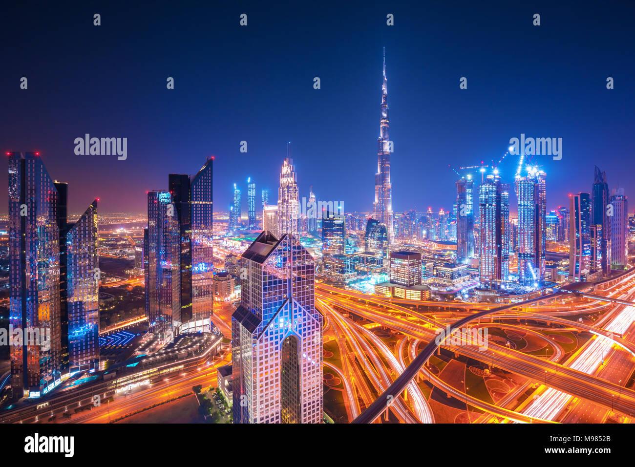 Dubai skyline at sunset with beautiful city center lights and Sheikh Zayed road traffic, Dubai, United Arab Emirates - Stock Image