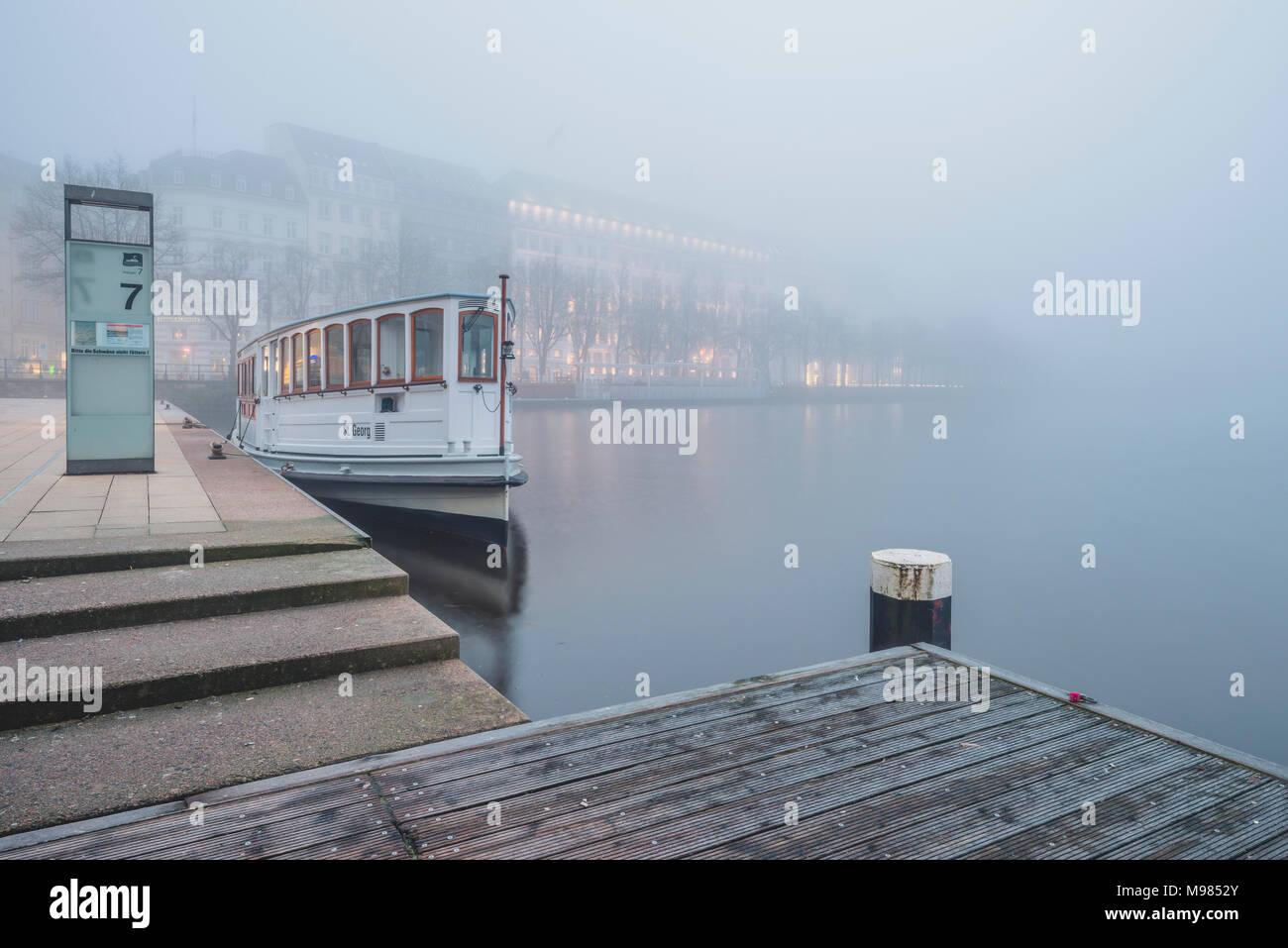 Germany, Hamburg, Jungfernstieg and passenger ship in fog - Stock Image