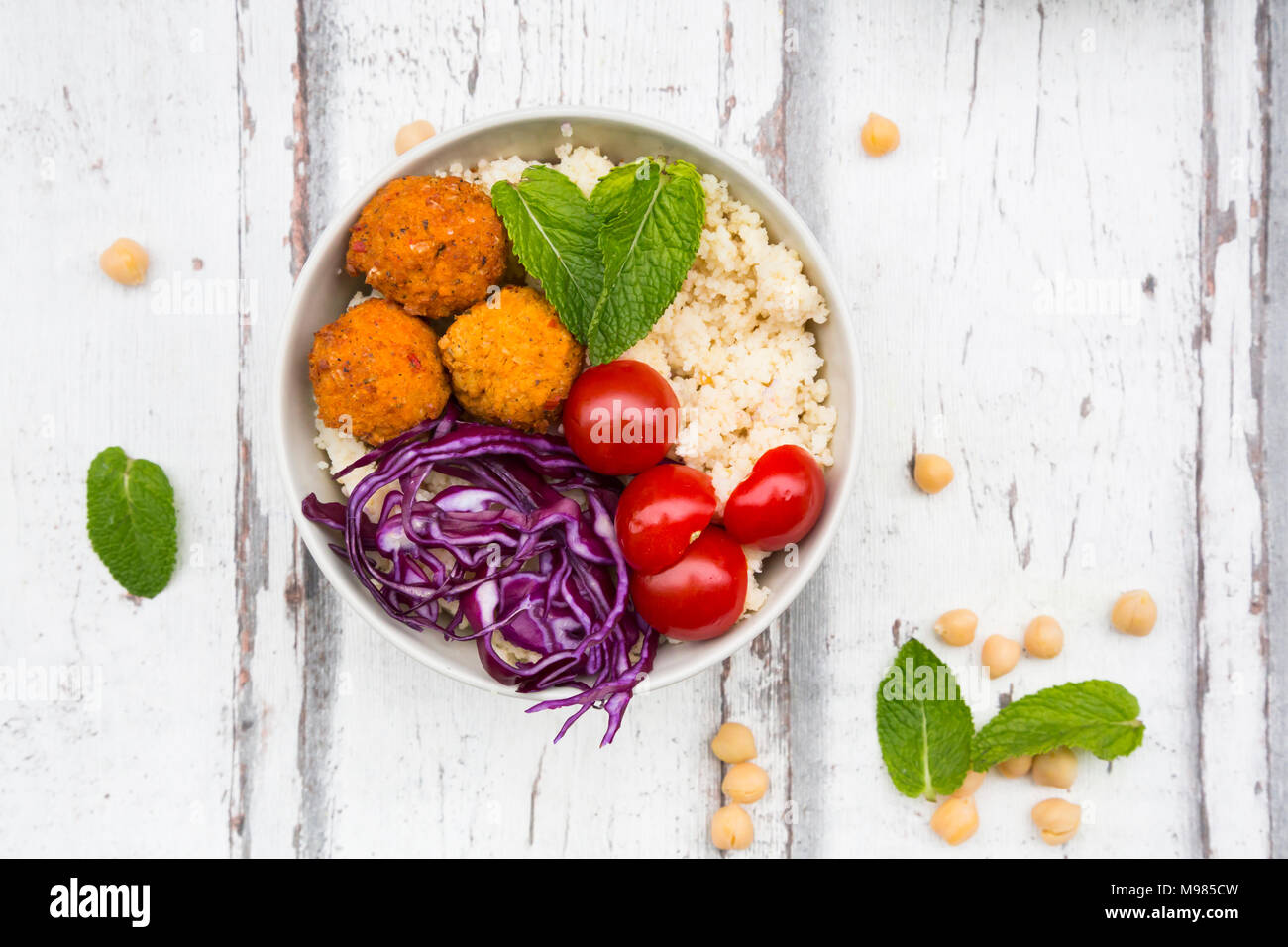 Buddha bowl of sweet potato balls, Couscous, Hummus and vegetables Stock Photo