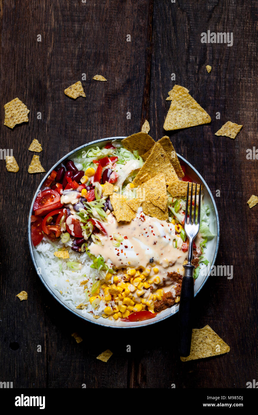 Taco Salad Bowl With Rice Corn Chili Con Carne Kidney Beans Iceberg Lettuce Sour Cream Nacho Chips Tomatoes Stock Photo Alamy
