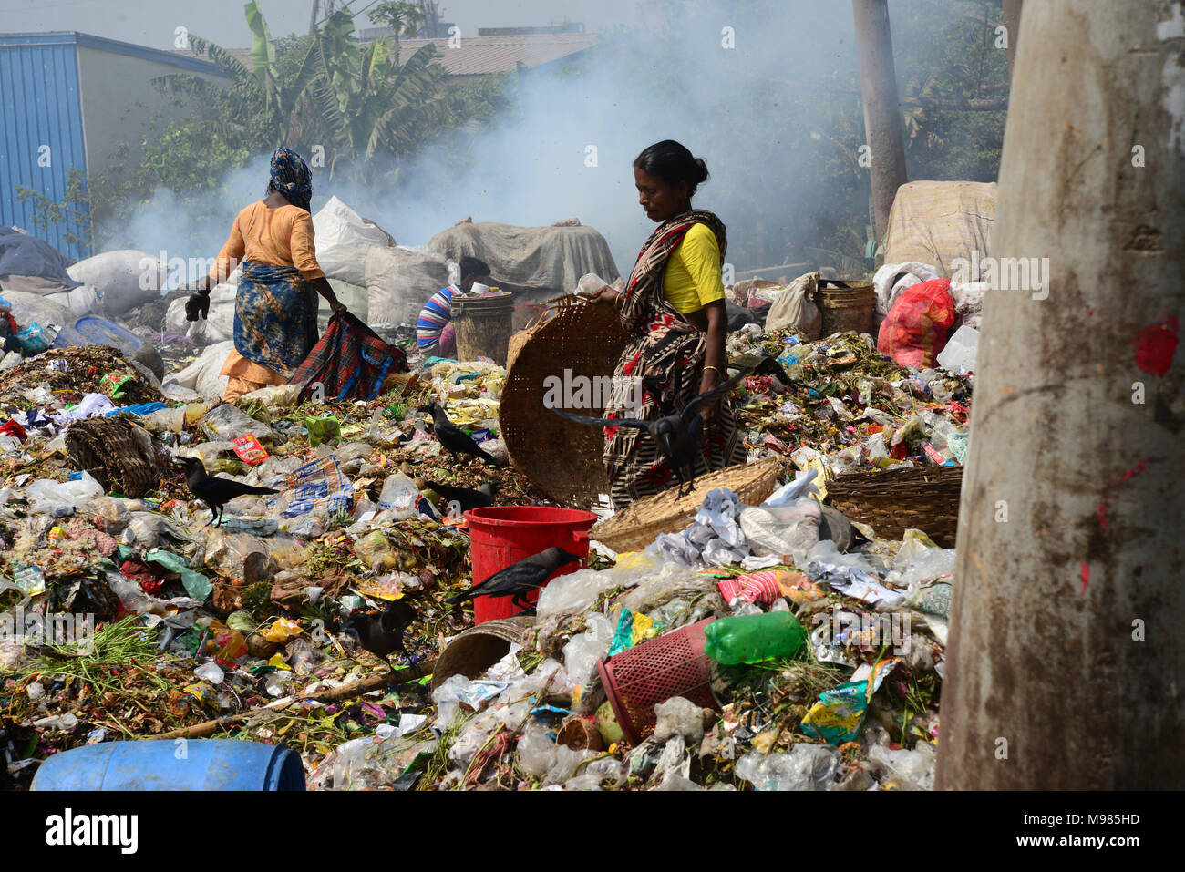 Bangladeshi people waste picker picks the non- biodegradable waste to be used for the recycling industry in waste Dump Yard in Dhaka. Bangladesh. On M - Stock Image