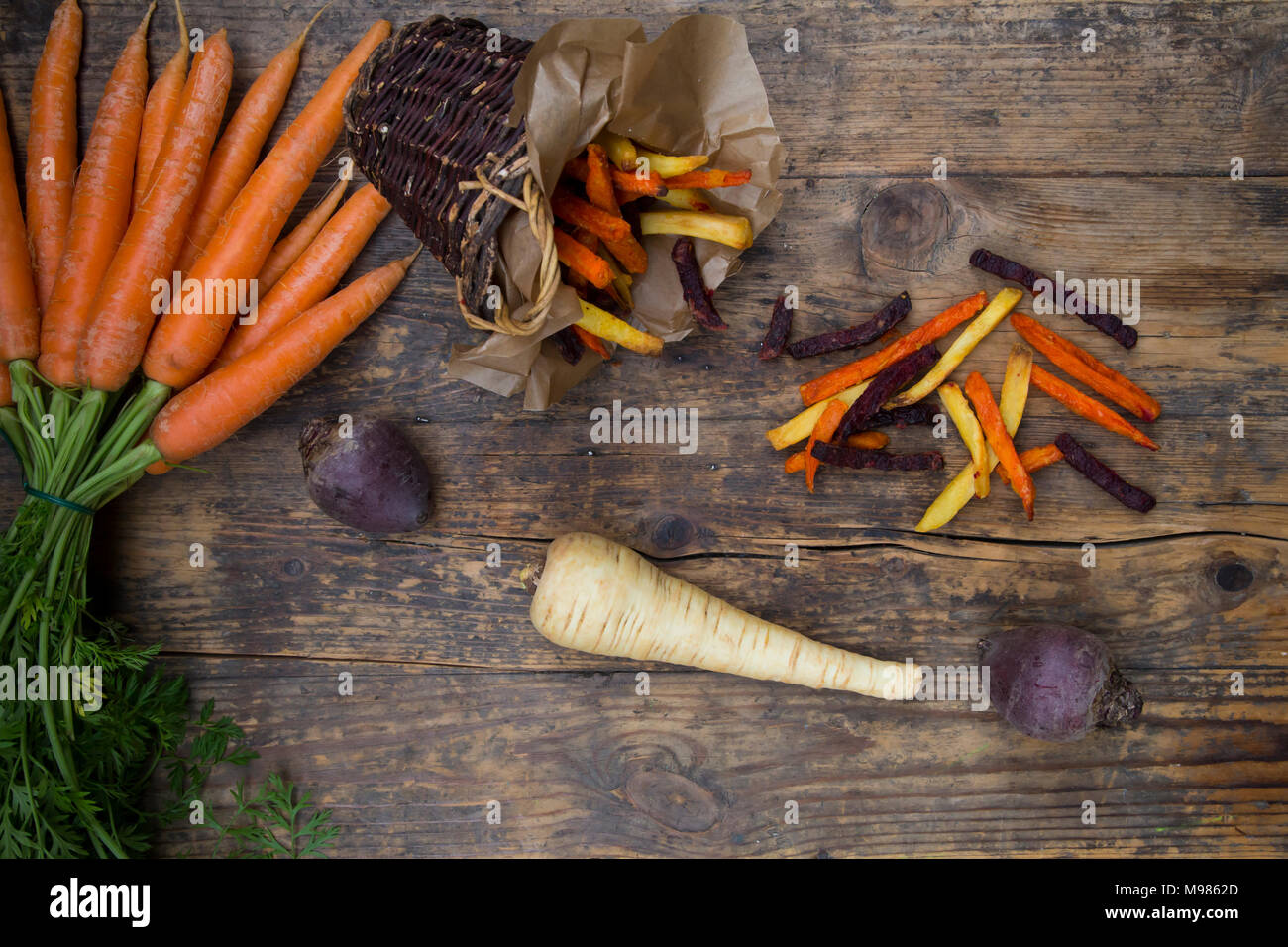 Organic beetroot, carrot and parsnip fries - Stock Image