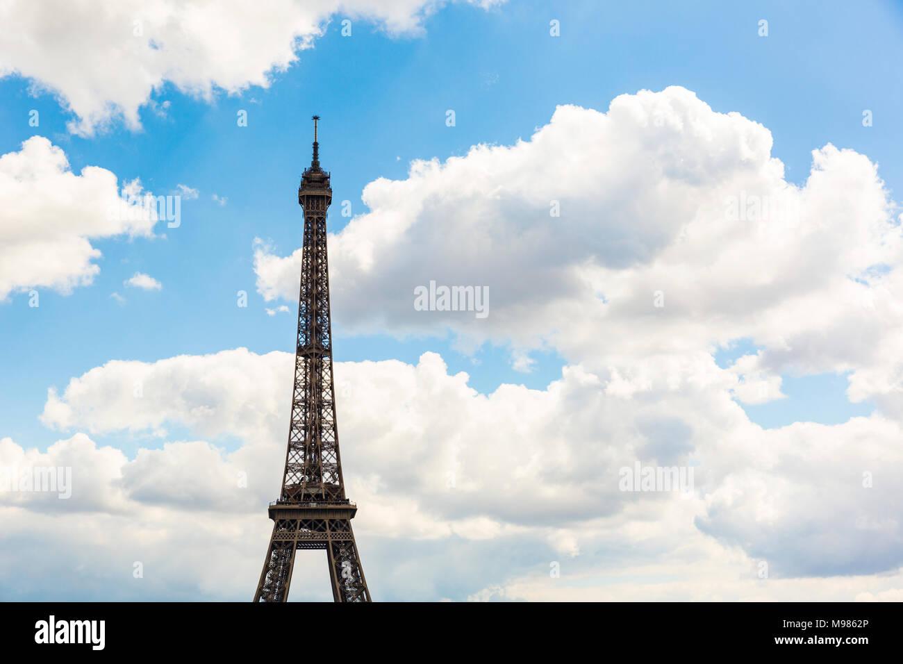 France, Ile-de-France, Paris, Eiffel Tower and clouds - Stock Image