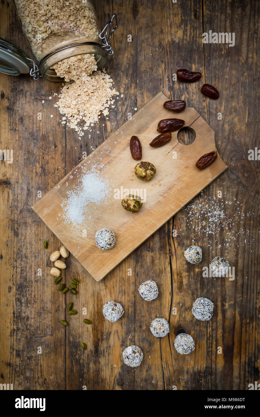 Bliss Balls with dates, pistachio, oat flakes and coconut flakes - Stock Image