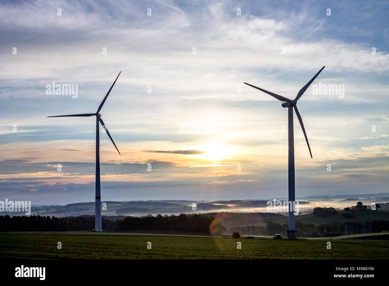 Germany, Hesse, Taunus, wind wheels in the evening - Stock Image