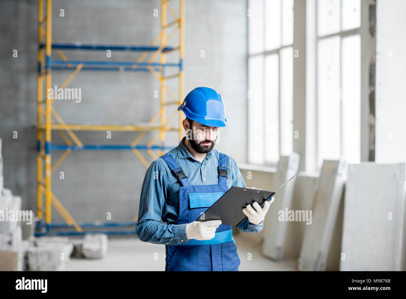 Builder at the construction site - Stock Image