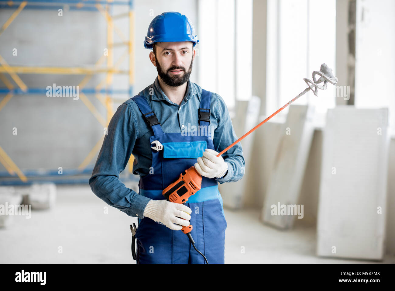 Builder with drill - Stock Image