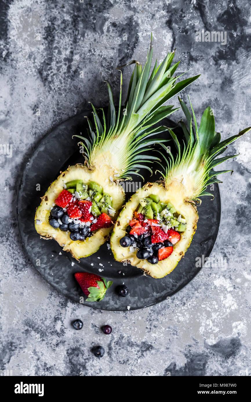 Sliced ananas with fruits, kiwi, strawberry and blueberry - Stock Image