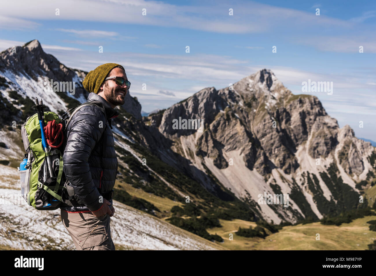 Austria, Tyrol, smiling young man on a hiking trip in the mountains - Stock Image