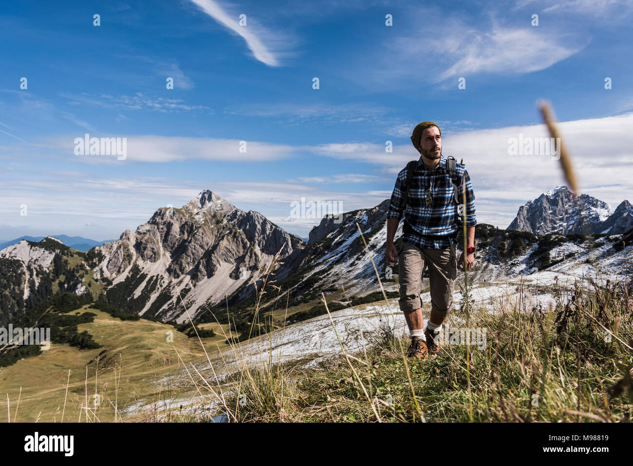 Austria, Tyrol, young man hiking in the mountains - Stock Image