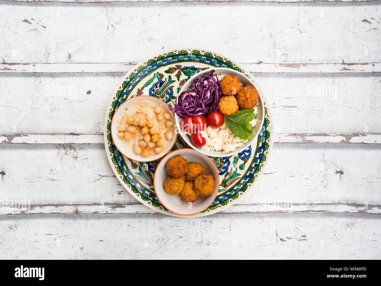 Sweet potato balls, Couscous, Hummus and vegetables in bowls Stock Photo