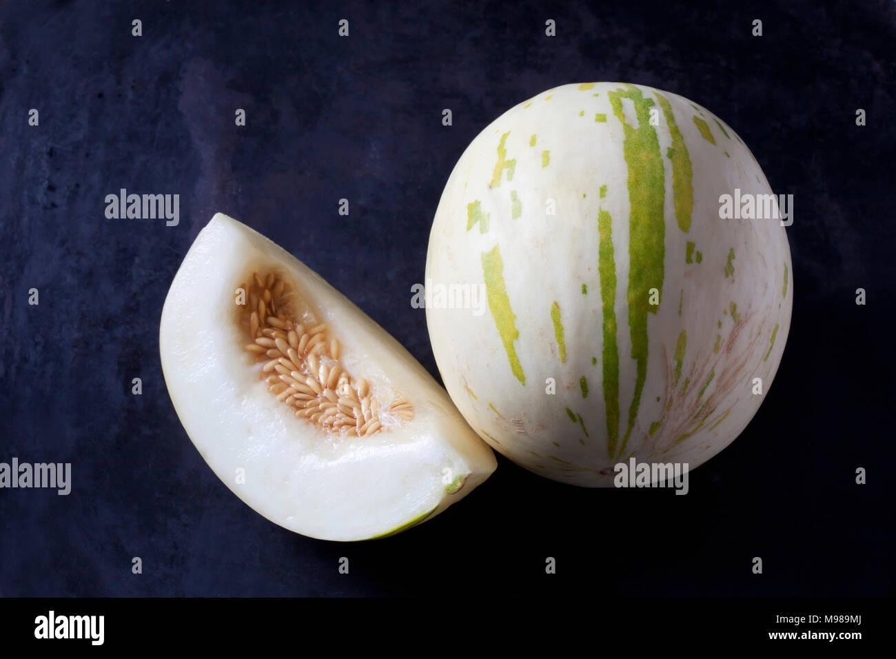 Snowball Melon on dark ground - Stock Image