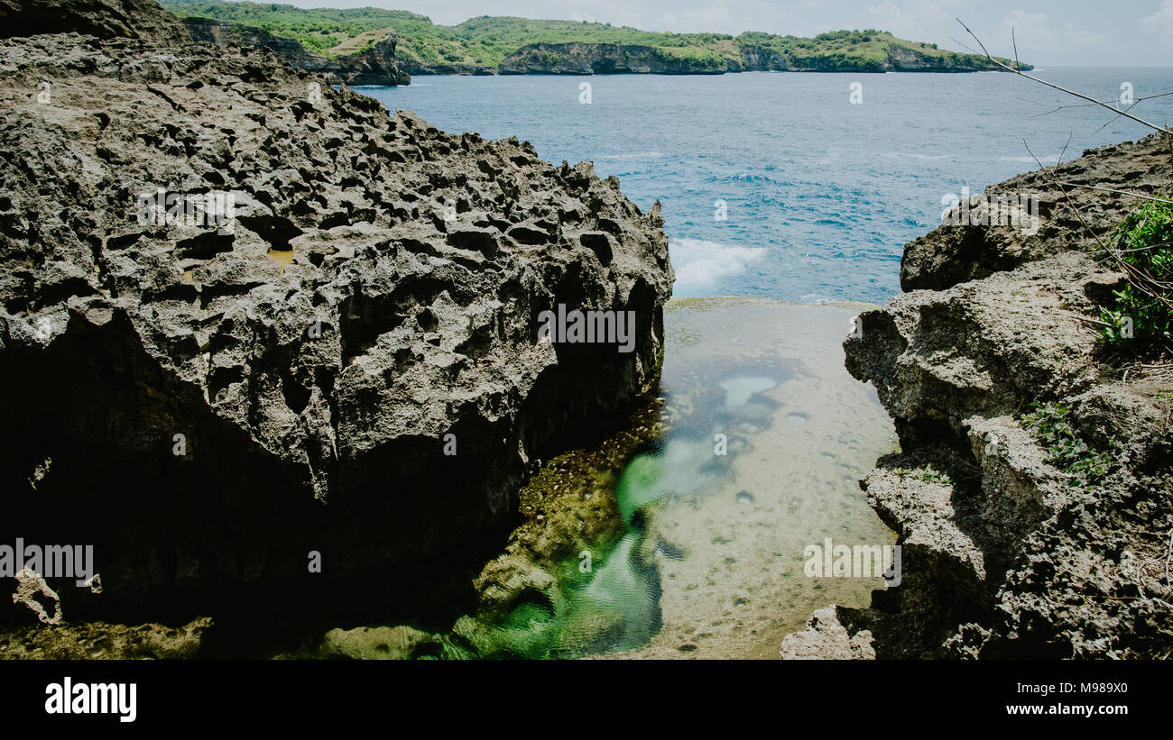 Angels Billabong, beautiful Cliff Formation with Yellow Pool, Bizarre Place, Nusa Penida Bali Indonesia - Stock Image