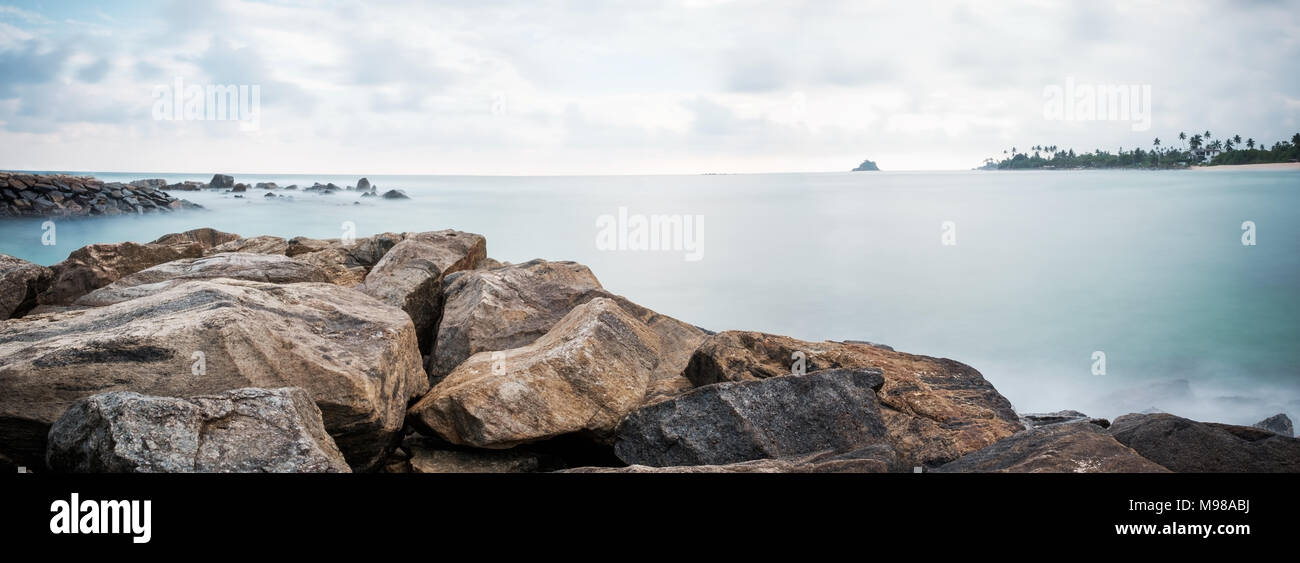 Landscape view on rocky coast ocean in Midigama Srilanka. View on surf spot - Stock Image