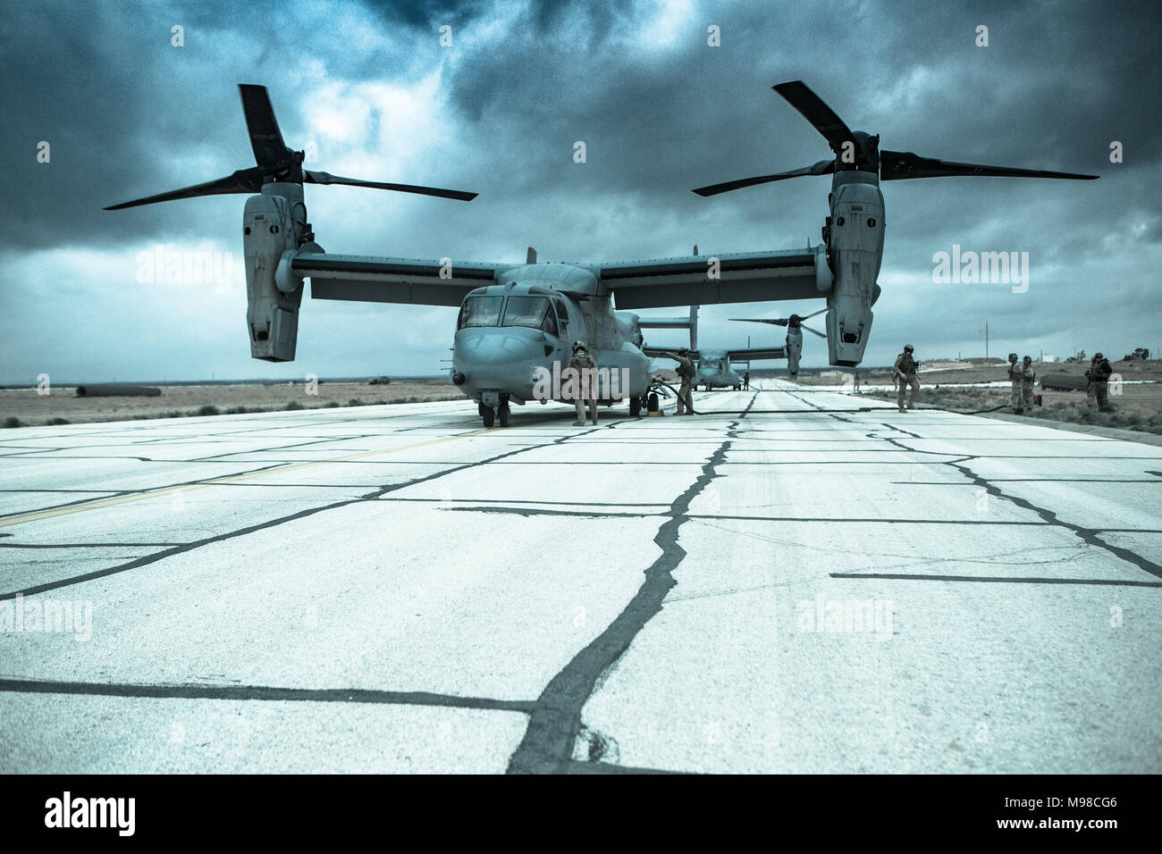 U.S. Marines with Marine Medium Tiltrotor Squadron 363 and Marine Wing Support Squadron 373, Special Purpose Marine Air-Ground Task Force – Crisis Response – Central Command, refuel two MV-22B Osprey tiltrotor aircraft at a forward arming and refueling point (FARP) Feb. 26, 2018. The FARP was set up by Marines with MWSS-373 so the Osprey could refuel mid-mission. Stock Photo