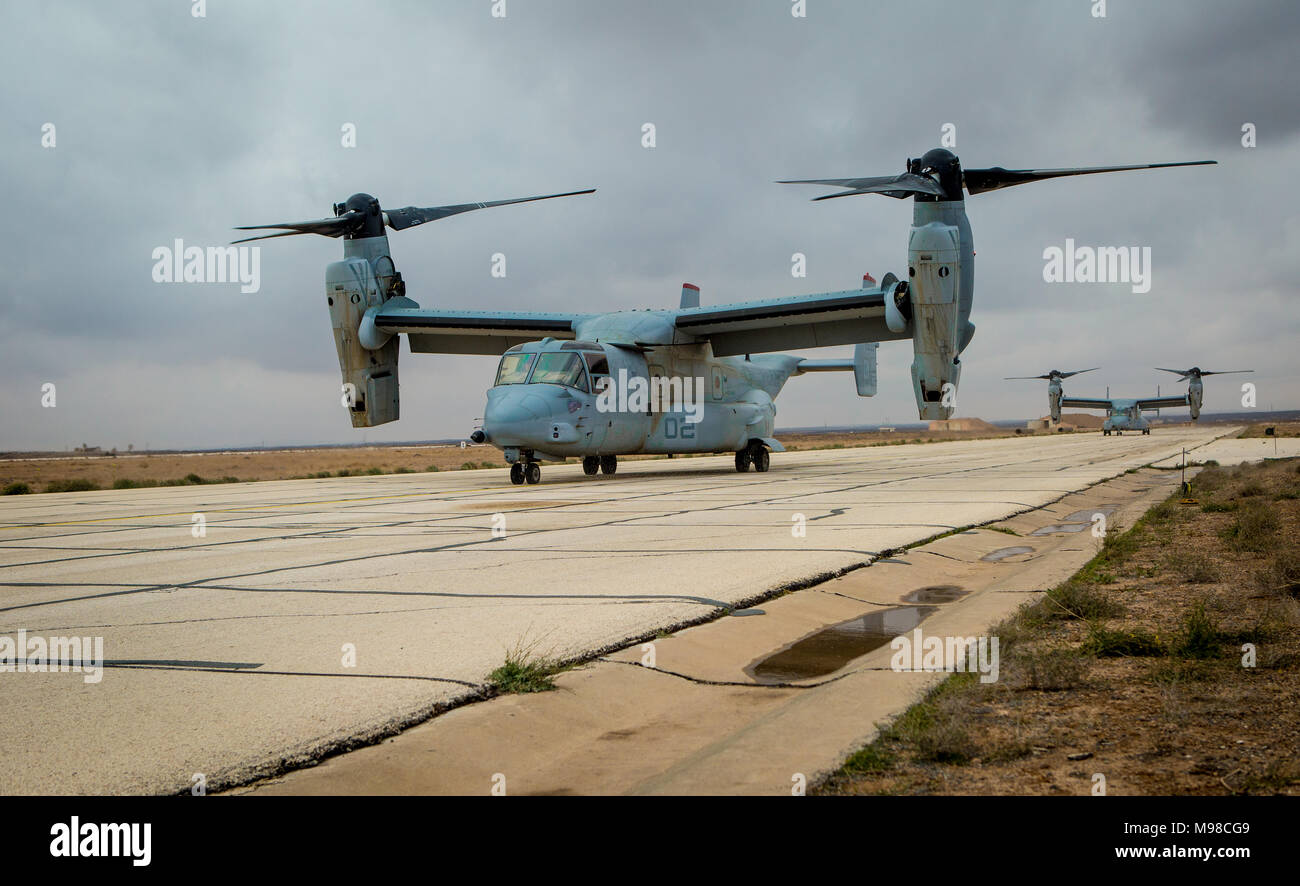 MV-22B Osprey tiltrotor aircraft with Marine Medium Tiltrotor Squadron 363, Special Purpose Marine Air-Ground Task Force – Crisis Response – Central Command, land at a forward arming and refueling point (FARP) Feb. 26, 2018. The FARP was set up by Marines with Marine Wing Support Squadron 373, SPMAGTF-CR-CC, so the MV-22B Osprey tiltrotor aircraft could refuel mid-mission. Stock Photo