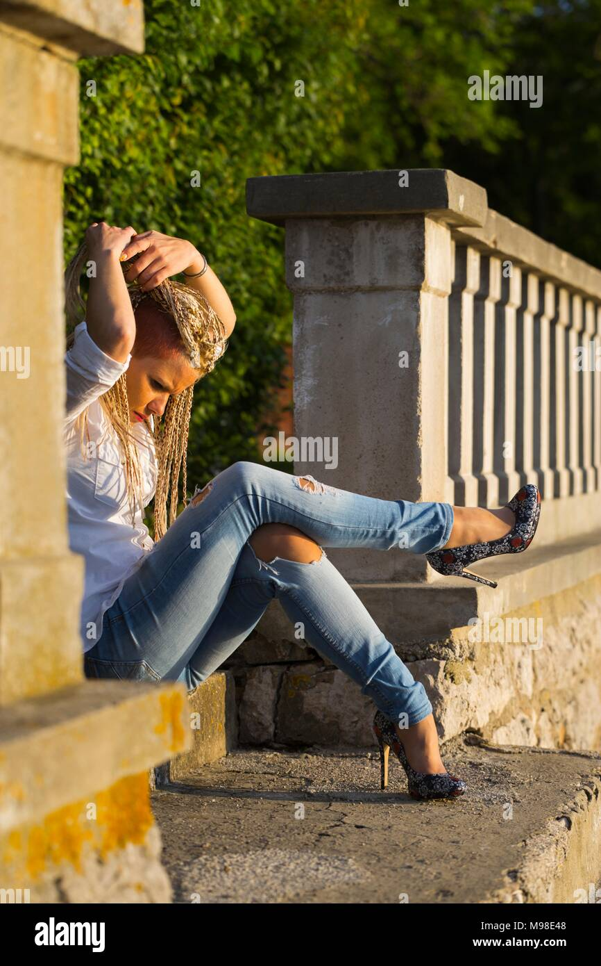 Young woman heeled shoes high heels model-released release alpfabet - Stock Image
