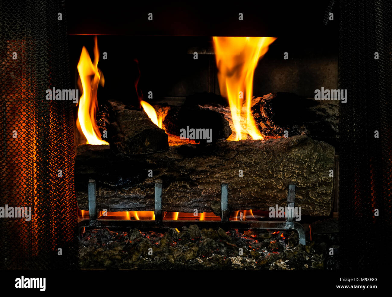 gas fireplace with logs and flame Stock Photo