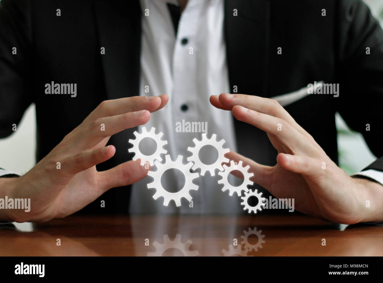 Integrated processes - hands protecting process chain - Stock Image