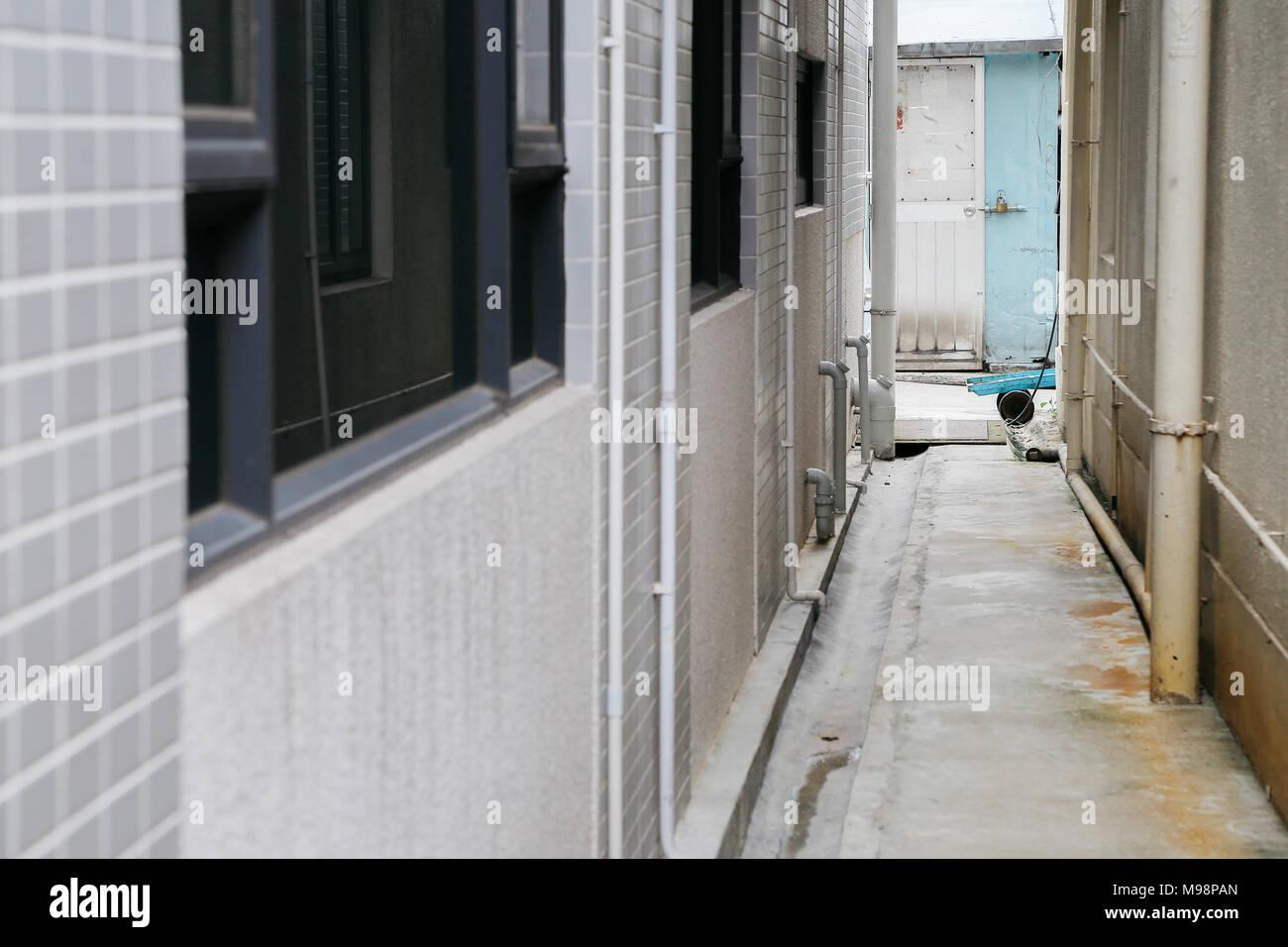 Narrow back street in HongKong - Stock Image