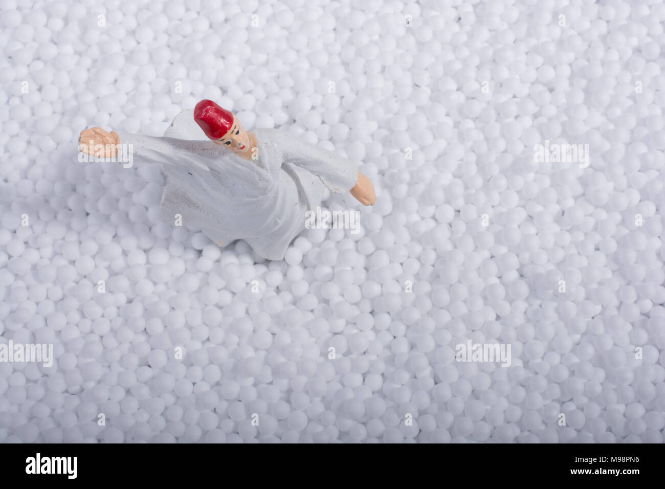Sufi Whirling Dervish on little  white polystyrene foam balls - Stock Image