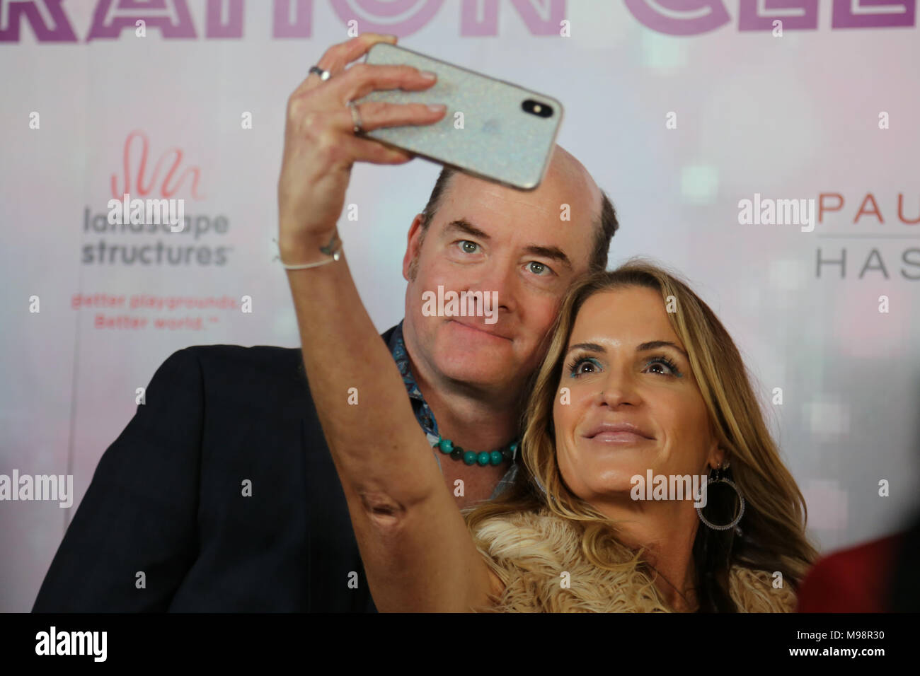 """Los Angeles, CA / USA - March 10, 2018: Actors David and Leigh Koechner pose for a photo at the Shane's Inspiration """"Boogie Wonderland"""" themed gala. Stock Photo"""