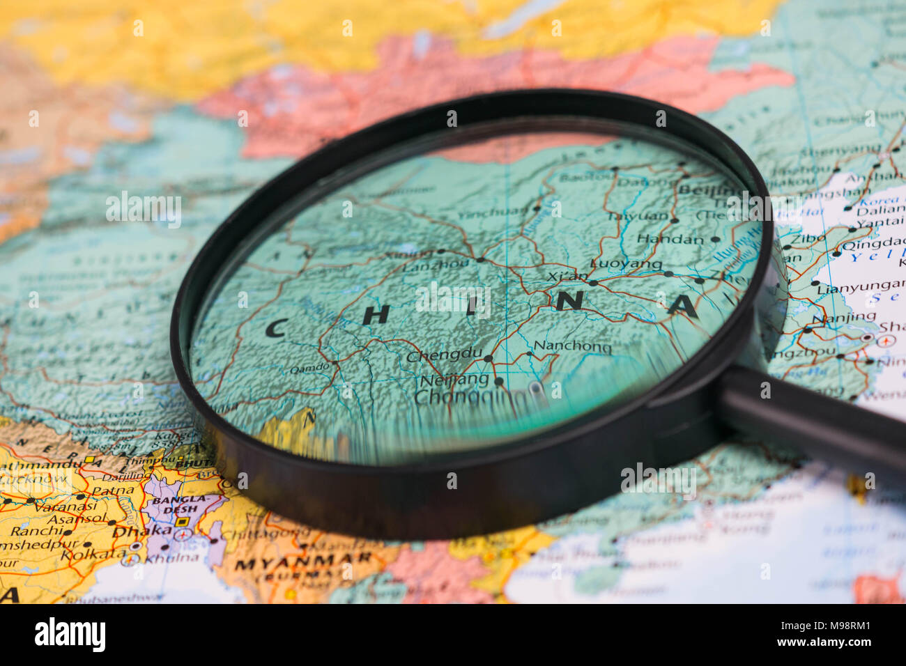 Map of china through magnifying glass on a world map stock photo map of china through magnifying glass on a world map gumiabroncs Image collections