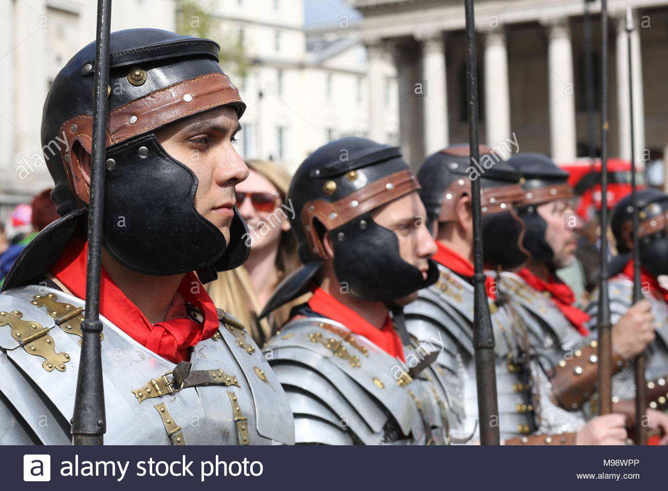 A group of participants dressed up in Trafalgar Square as Roman soldiers where the Easter performances were held at the weekend. - Stock Image