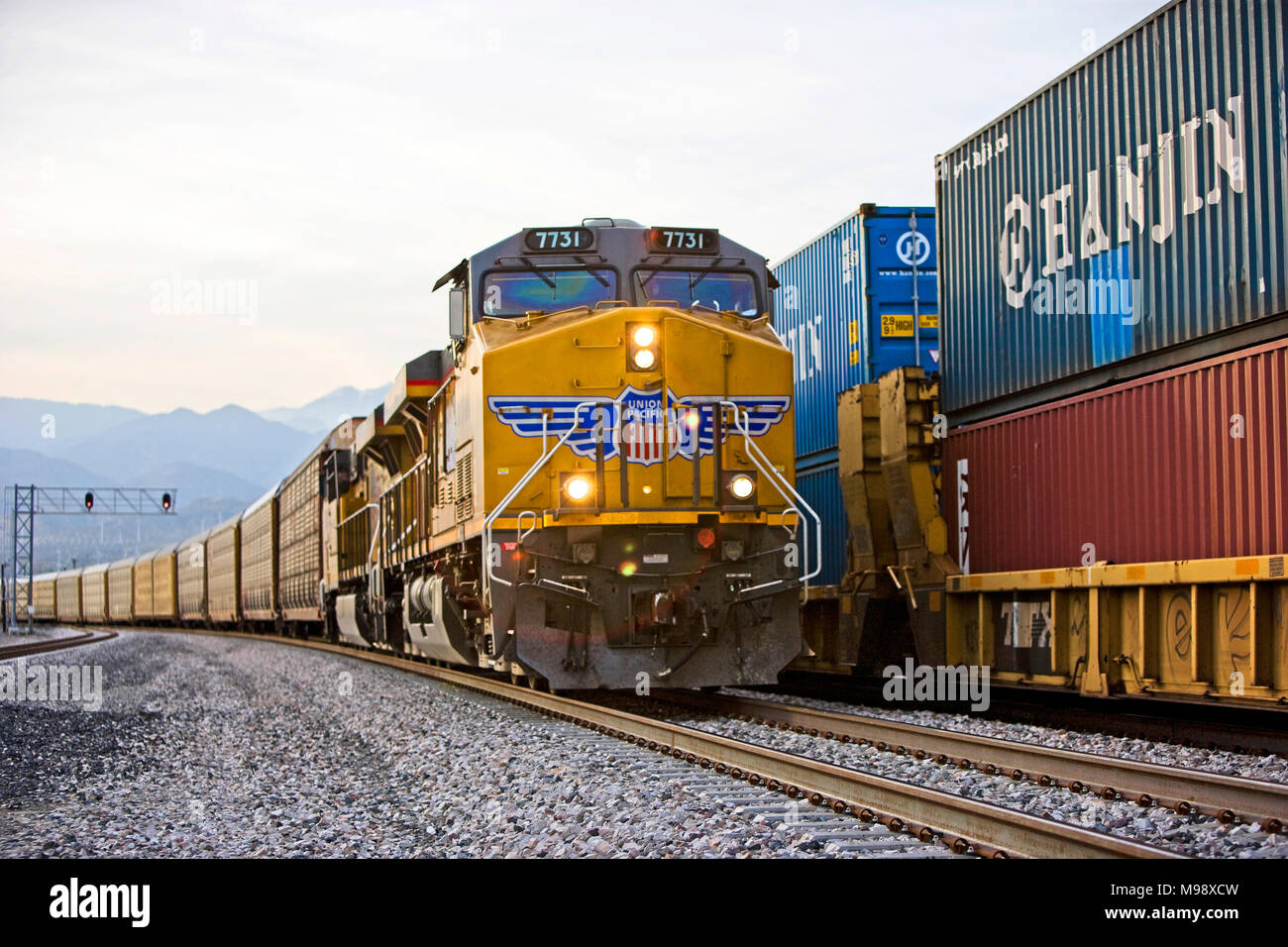 Freight train moves through the Coachella valley of southern California pulled by a string of union pacific diesel locomotives - Stock Image