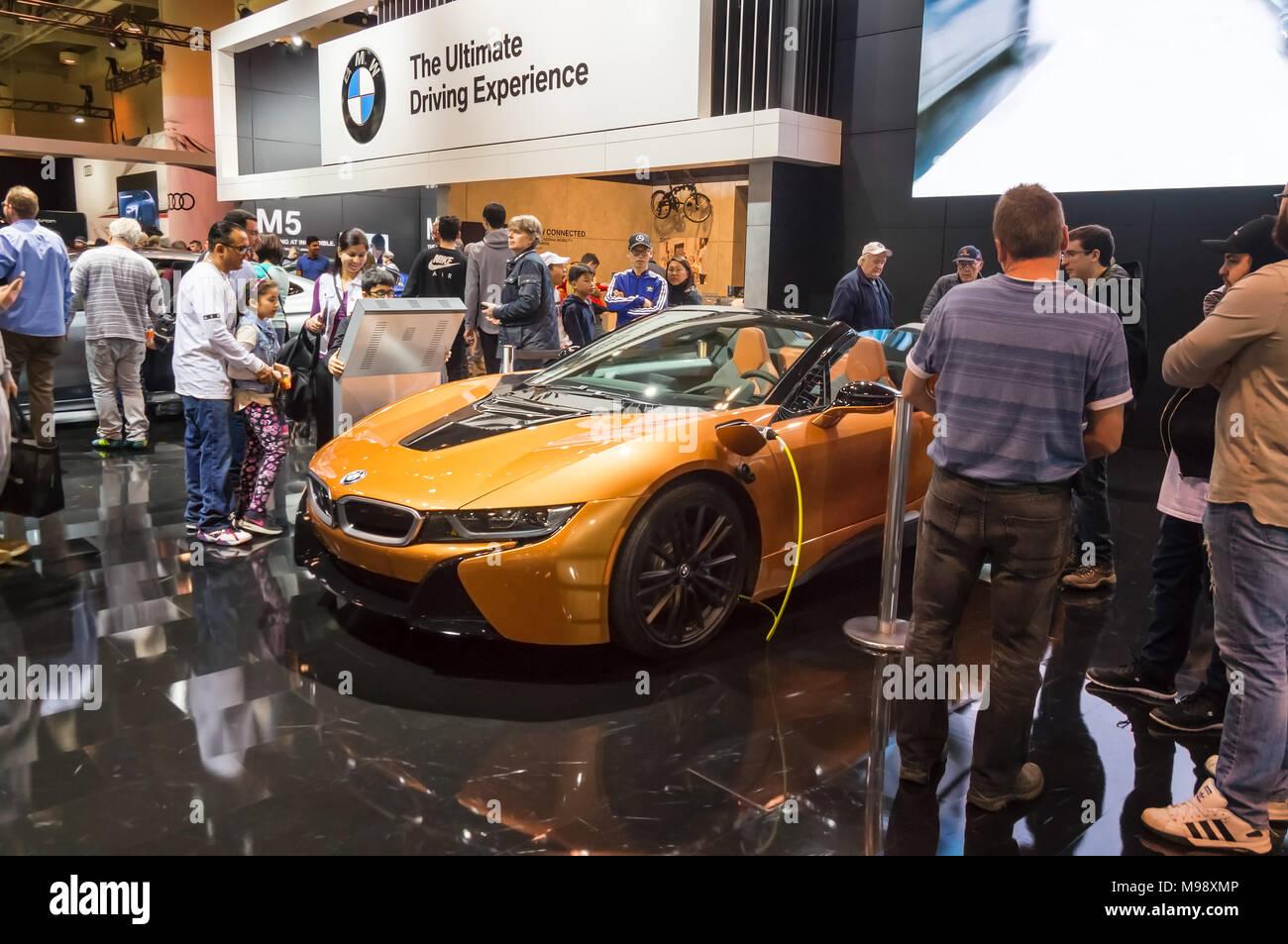 Toronto, Canada - 2018-02-19: Visitors of 2018 Canadian International AutoShow around the BMW i8 plug-in-hybrid car on Bayerische Motoren Werke AG exposition - Stock Image