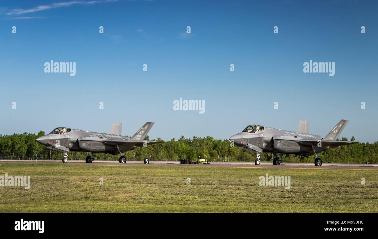 Two Lock Martin F-35A fighter jets being prepared for takeoff at the 2017 Airshow at Duluth, Minnesota, USA. - Stock Image