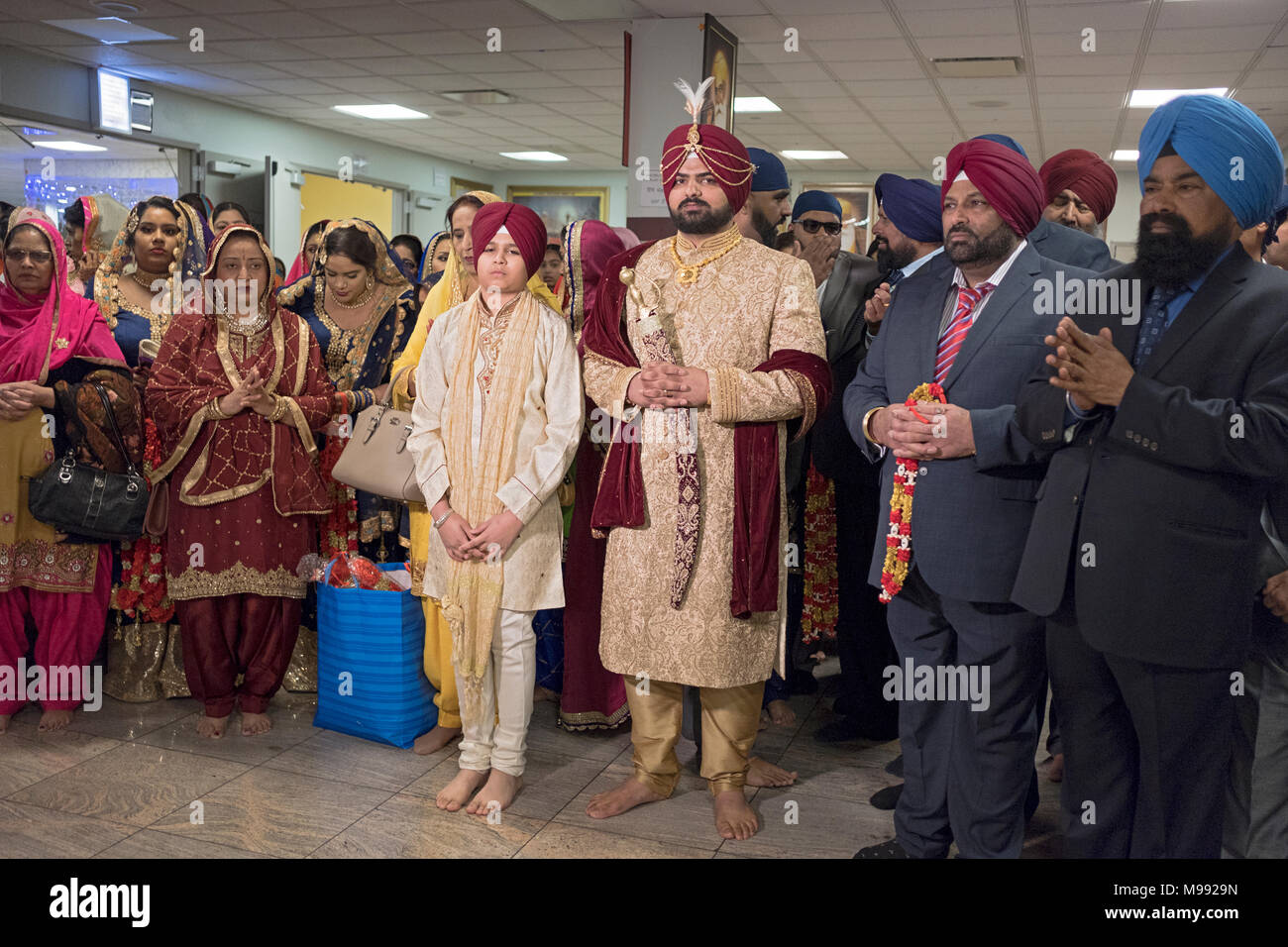 A groom and his brother at a Sikh wedding ceremony in Richmond Hill, Queens New York. Stock Photo