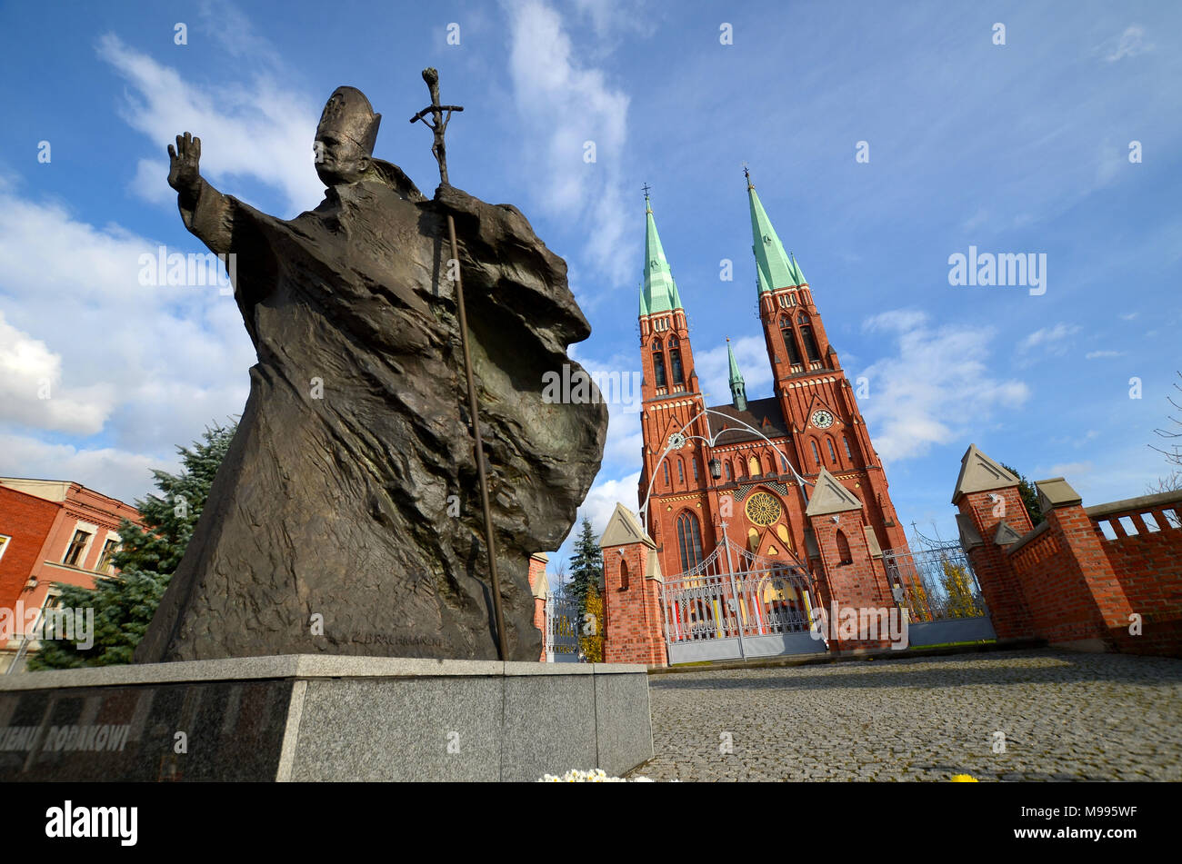 Statue of John Paul II against the background of the cathedral (Rybnik, Poland) - Stock Image