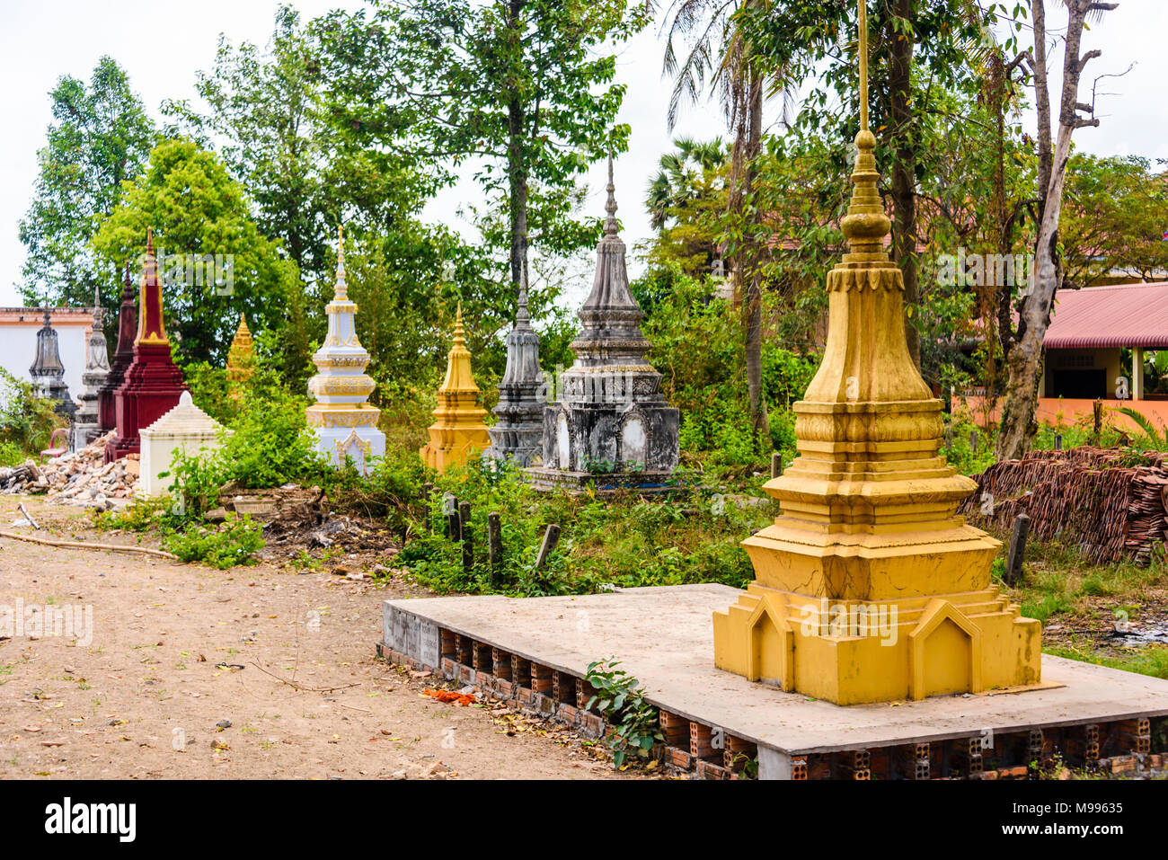 Stupa, traditional Buddhist burial gravestones at a temple in a rural area of Cambodia Stock Photo