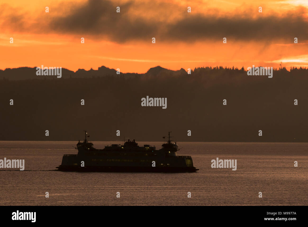 Puget Sound ferry and sunrise with Cascade mountains in background. Washington State ferries. Port Townsend ferry. - Stock Image