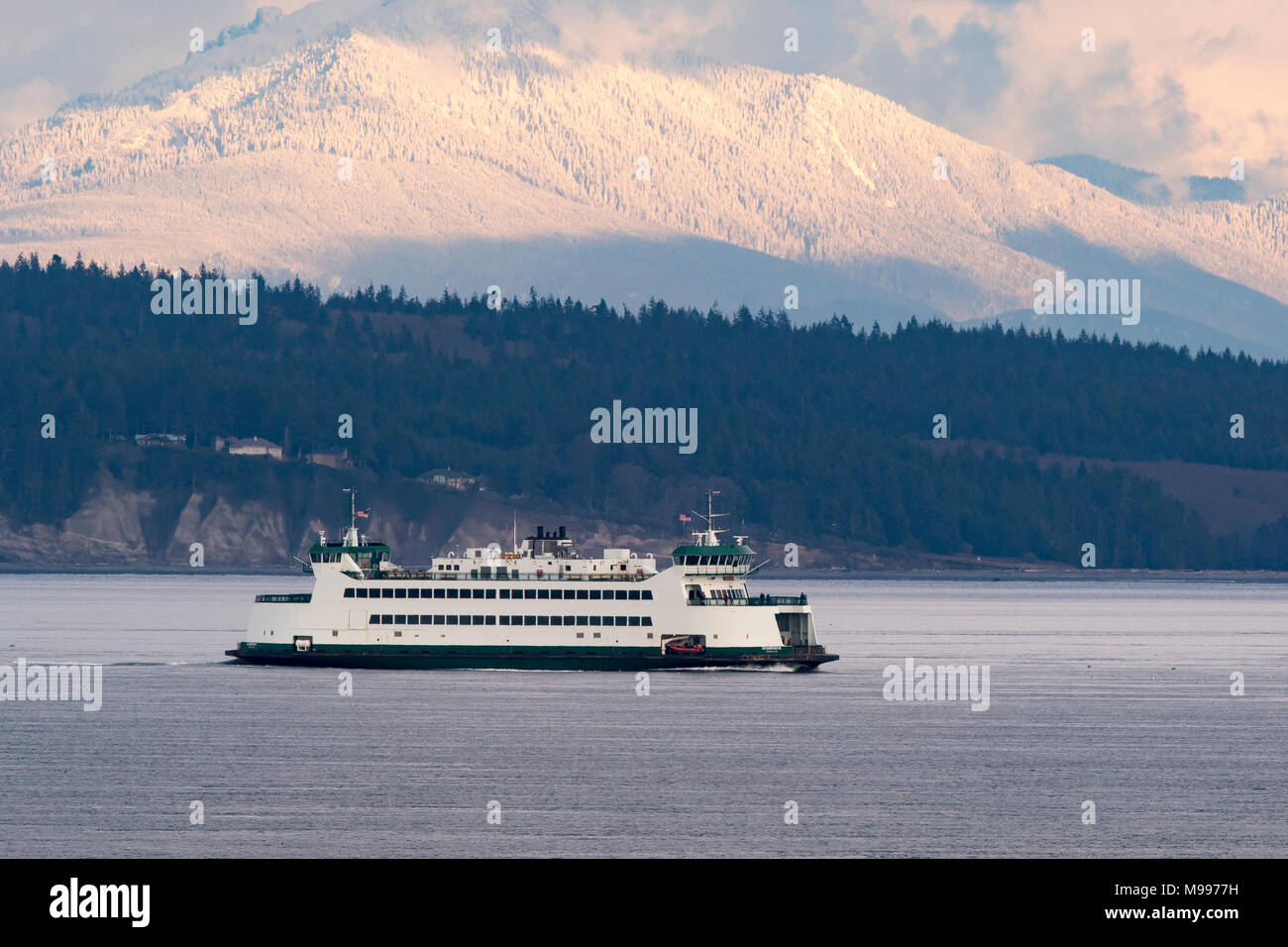 Puget Sound ferry with Cascade mountains in background. Washington State ferries. Port Townsend ferry. - Stock Image