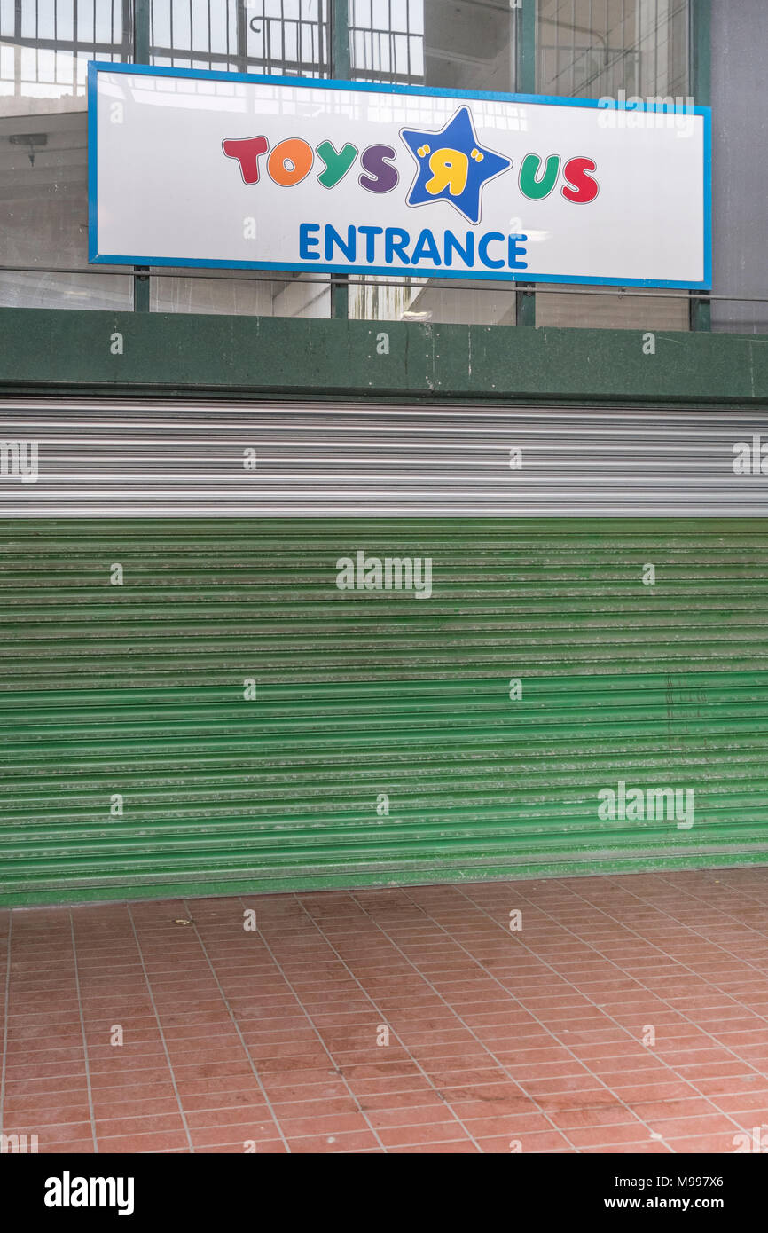 Front of the closed Toys R Us shop in Plymouth, Devon. Metaphor for high street retail casualties. Death of the high street metaphor, out of business. Stock Photo