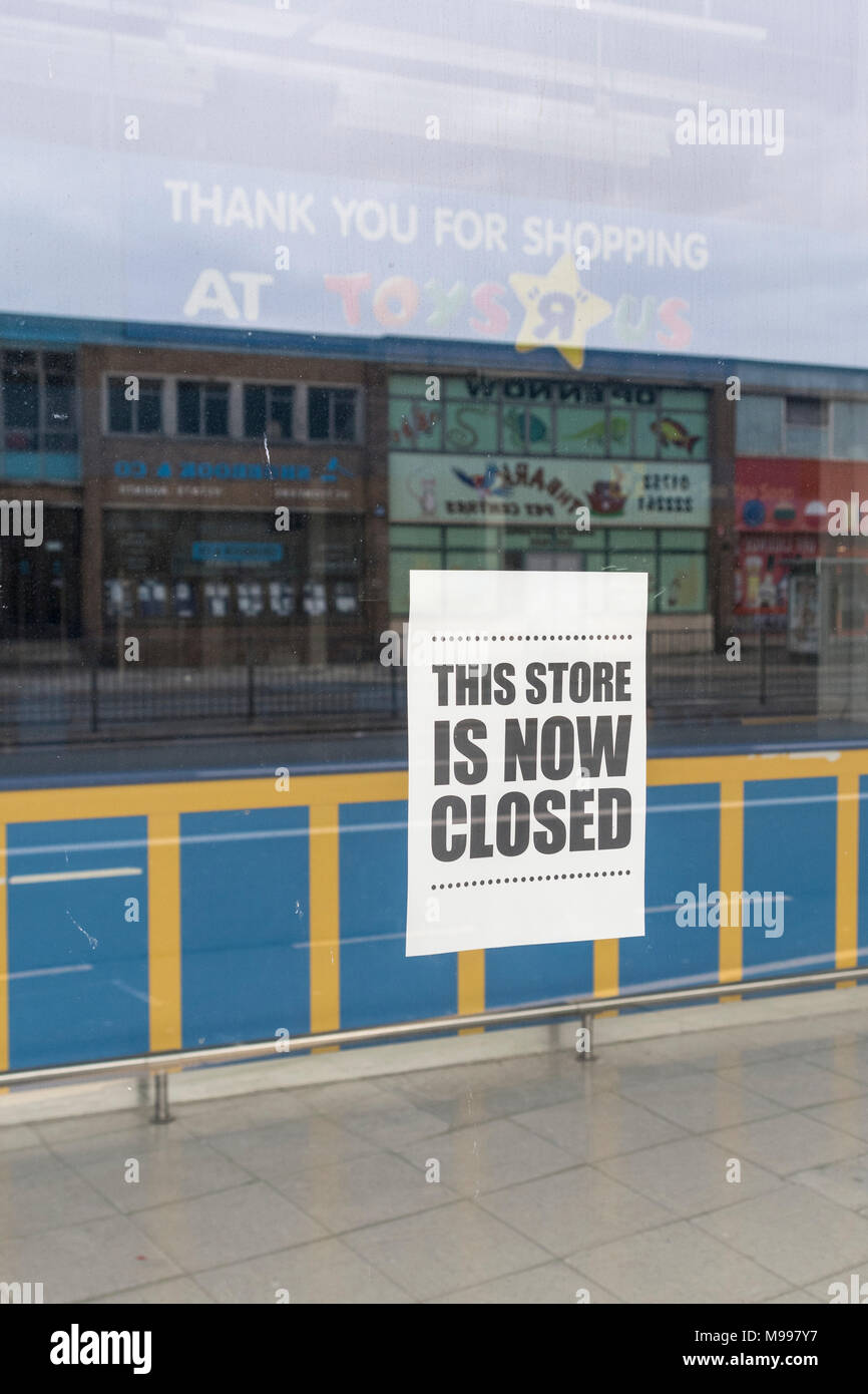 Front of the closed Toys R Us shop in Plymouth, Devon. Metaphor for high street retail casualties. Death of the high street metaphor, out of business. - Stock Image