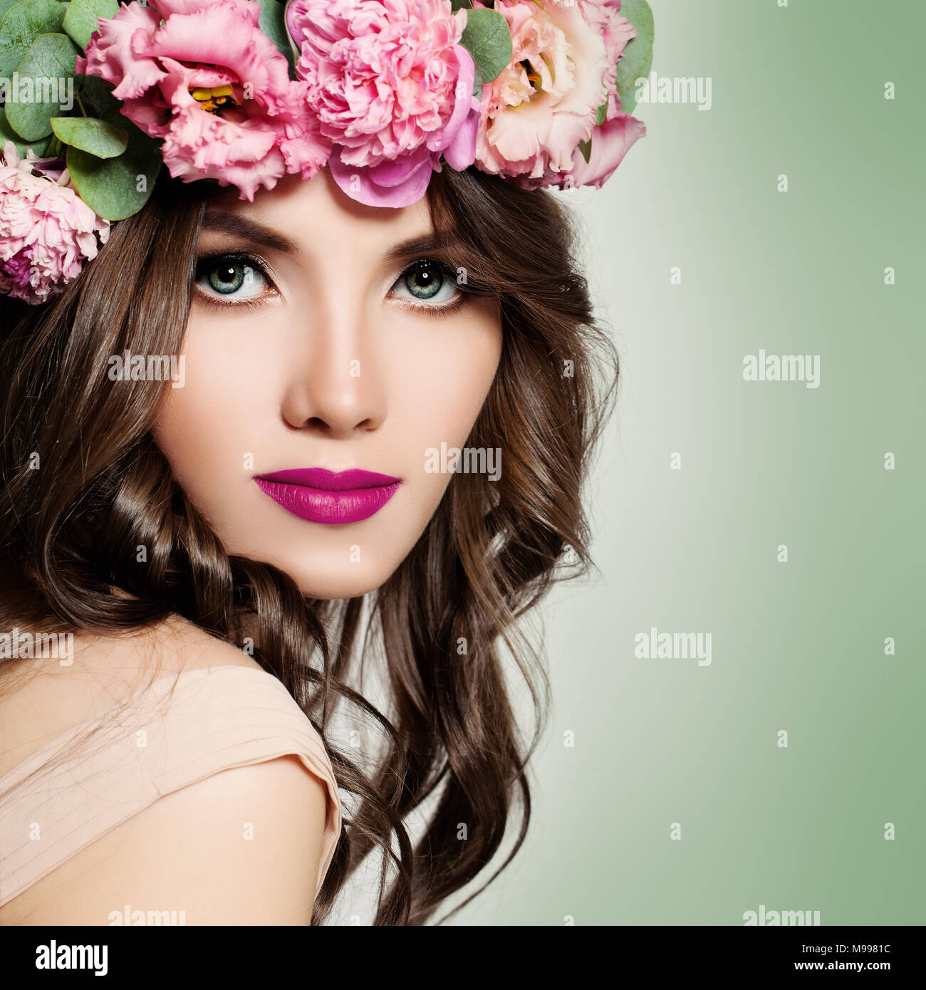 Beautiful girl pink flowers wreath stock photos beautiful girl beautiful girl with flowers wreath long permed curly hair and fashion makeup blossom portrait izmirmasajfo