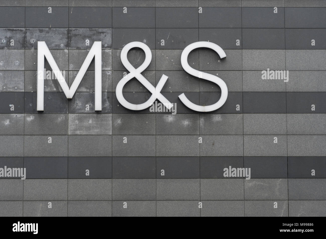 Marks and Spencer / M&S logo at Drake Centre mall, Plymouth. Possible metaphor for M&S store closures 2018, profit warning, profits plunge, job cuts. Stock Photo