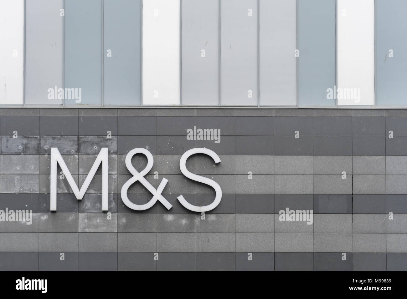 Marks and Spencer / M&S logo at Drake Centre mall, Plymouth. Possible metaphor for M&S store closures 2018, profit warning, profits plunge, job cuts. - Stock Image