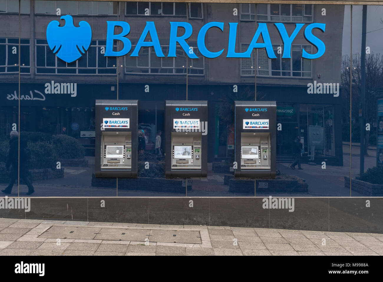 ATM at Barclays Bank site in Plymouth, Devon. Barclays first-quarter loss metaphor. - Stock Image