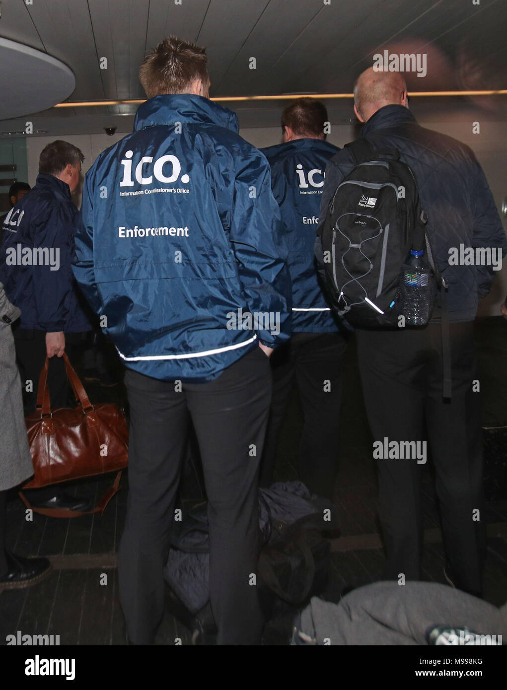 Enforcement officers working for the Information Commissioner's Office entering the offices of Cambridge Analytica in central London after a High Court judge granted a search warrant. - Stock Image