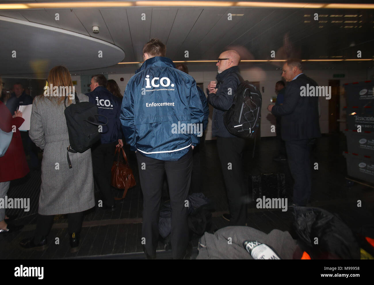 Enforcement officers working for the Information Commissioner's Office entering the premises of Cambridge Analytica in central London after a High Court judge granted a search warrant. - Stock Image