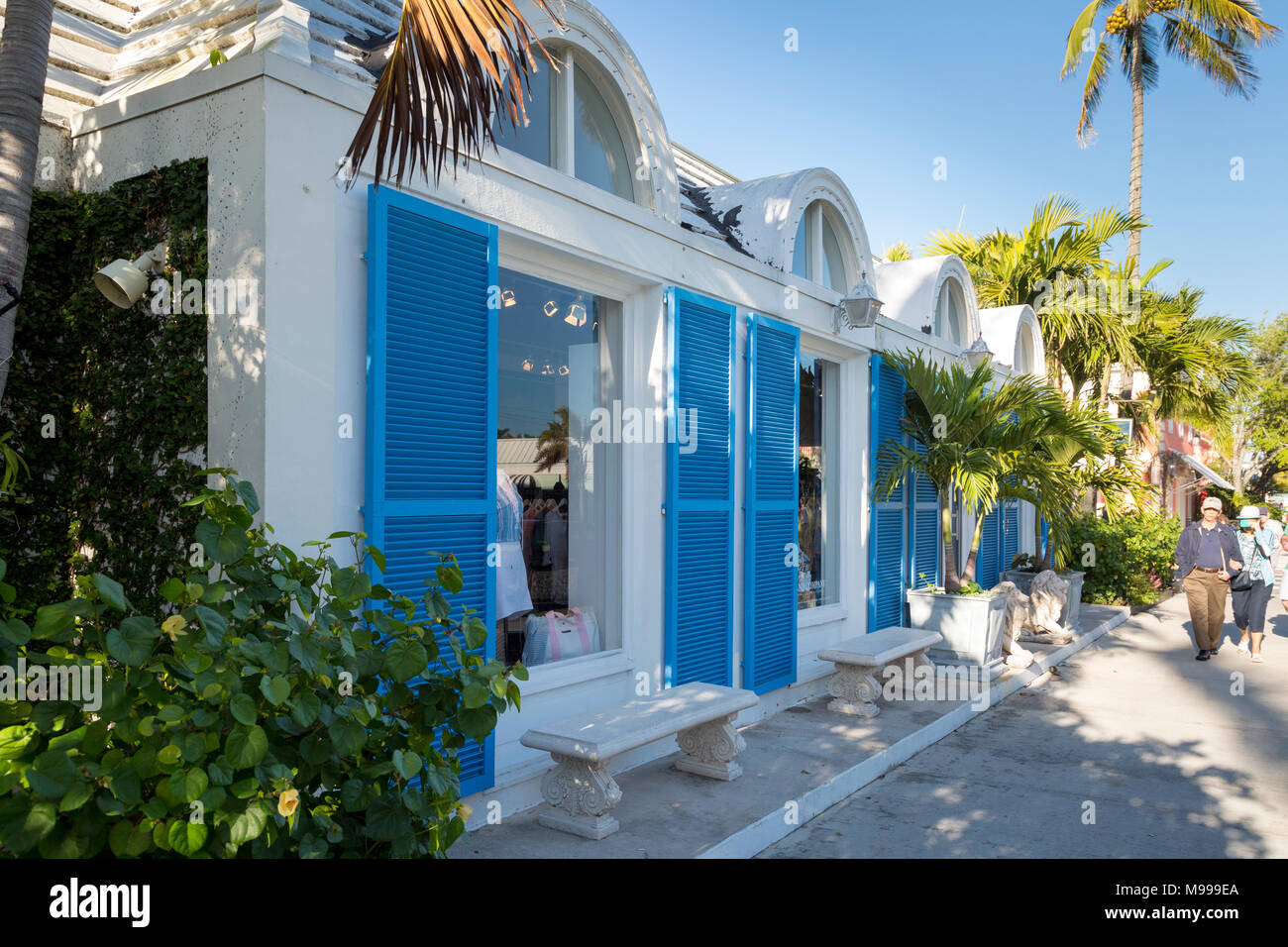 Blue shutters on French-inspired clothing boutique in 3rd Street shopping district, Naples, Florida, USA - Stock Image