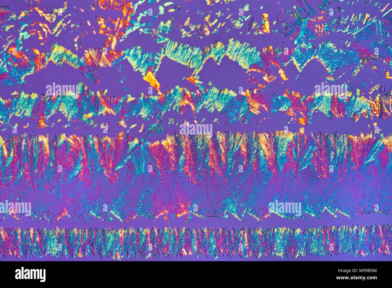 Brightfield cross polarized photomicrograph, glycerin with dextrin slide melt - Stock Image