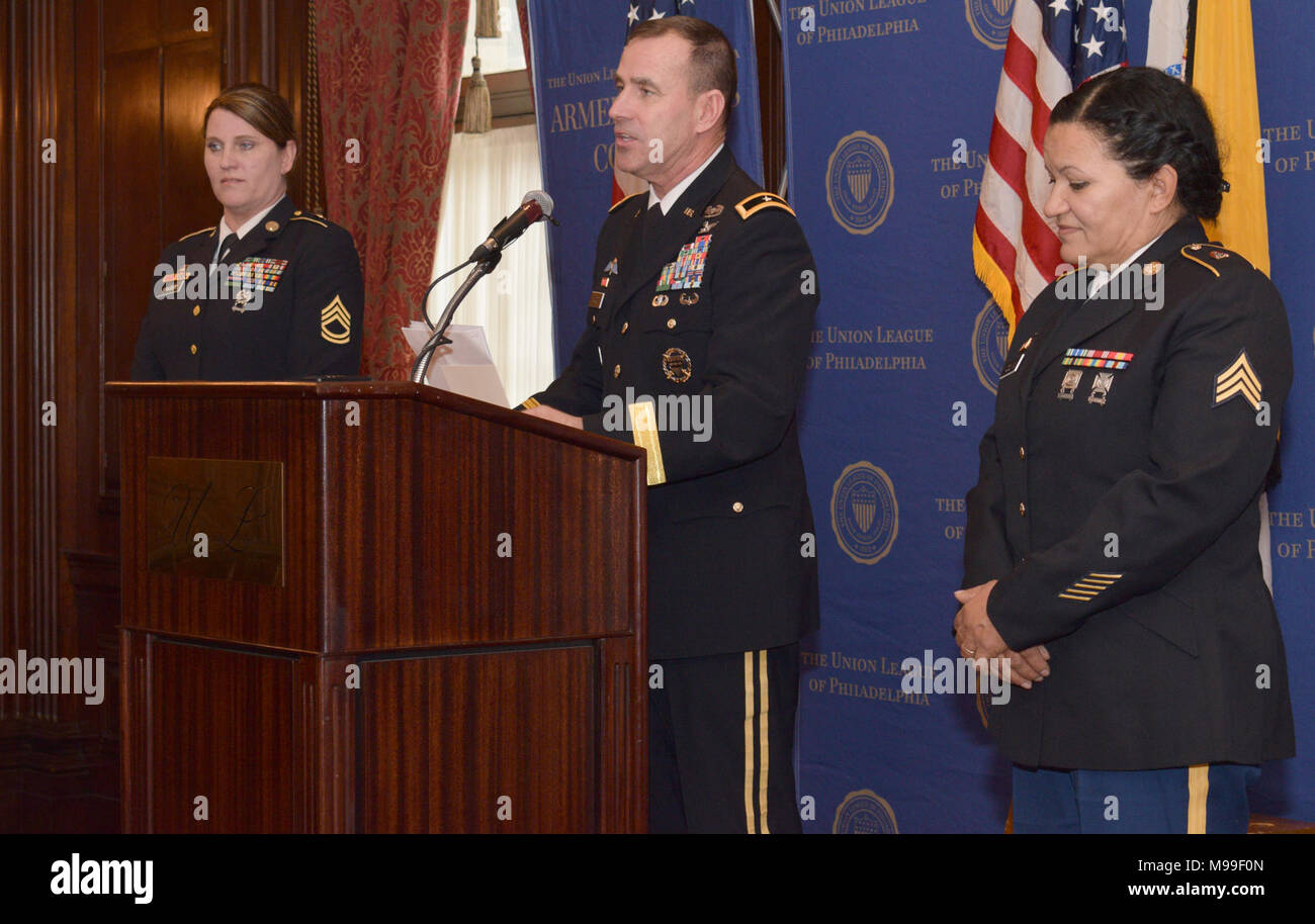 Brig. Gen. David Wood, director, Joint Staff-Pa Joint Force Headquarters (center),  reads aloud the accomplishments of Pennsylvania's Octavius V. Catto award recipients, Sgt. 1st Class Melissa Mae Singer (left), 28th Infantry Headquarters and Sgt. Laura Colvin, A Company 128th BSB. The ceremony was held at the Philadelphia Union League, Philadelphia, Pa., Feb. 17, 2018. (U.S. Air National Guard - Stock Image